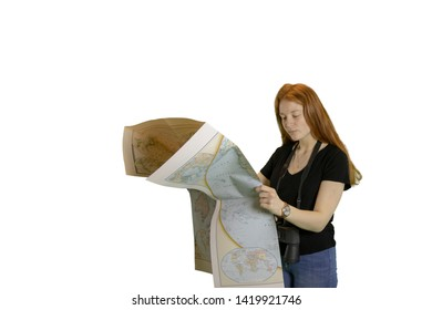 Teen girl holding world map isolated on white with copy space.