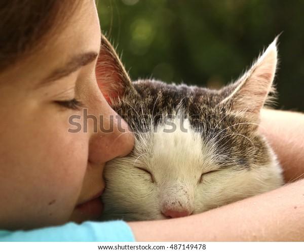 teen girl hug cat close up monochrome portrait on the summer garden background