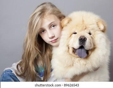 teen girl hugging a big dog  Chow chow