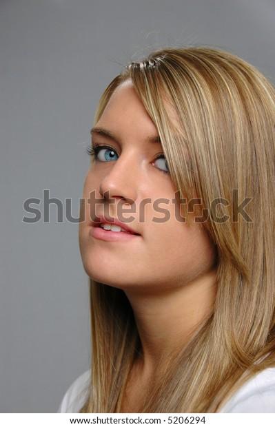 Teen girl isolated on gray background