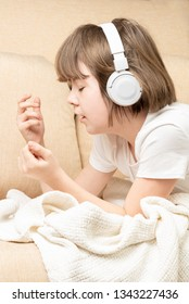 Teen girl listening music with headphones