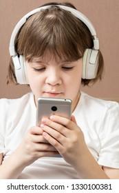 Teen girl looking to her smartphone