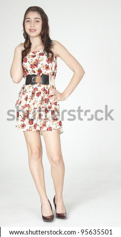 1c7b1f276 Teen Girl Modeling Short Dress and Heels Isolated Against a White Studio  Background