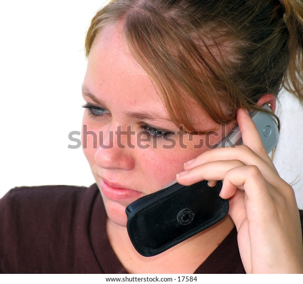 teen girl on a cell phone with white background