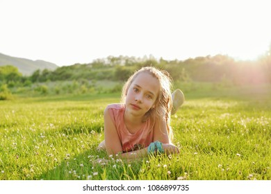 teen girl on the sunny meadow in backlit