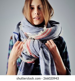 teen girl in plaid shirt wearing a scarf