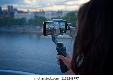 Teen girl records video with her mobile phone placed on a gimbal