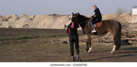 teen girl rides a lie
