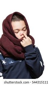 Teen girl with a scarf on the head, picking nose, isolated on white background