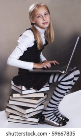 Teen girl in school uniform with a laptop on his lap