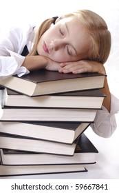 Teen girl in school uniform sleeping on thick books
