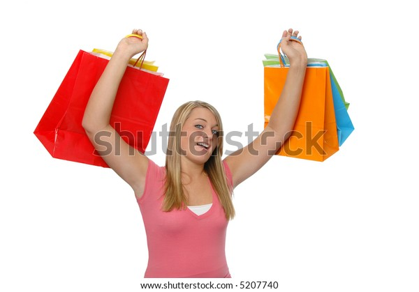 Teen girl with shopping bags isolated on white
