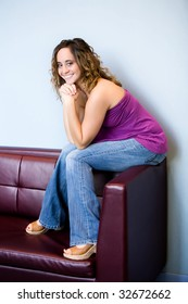 teen girl sitting on couch