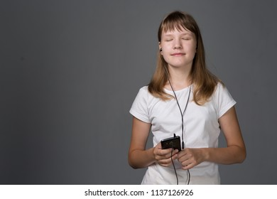 teen girl with smartphone on gray background