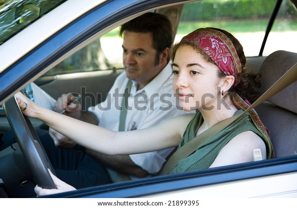 Teen girl taking driving test to get her drivers license.