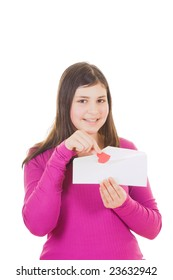 Teen girl taking  heart shaped valentine out of envelope