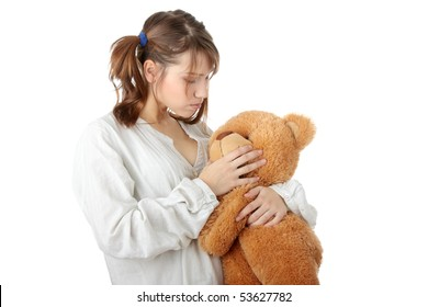 Teen girl with teddy bear, isolated on white background
