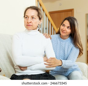 Teen girl tries reconcile with  mother in home. Focus on mature