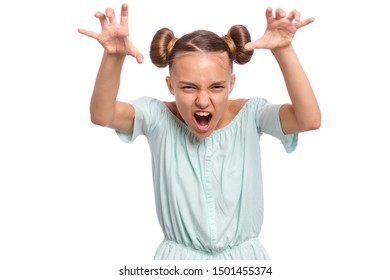 Teen girl trying to frighten someone with stretched hands. Emotional portrait of angry girl with hand up, isolated on white background. Negative human emotion, facial expression.
