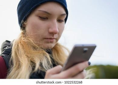 teen girl using smartphone outdoors