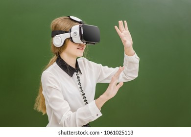 Teen girl using VR headset  on the background of a school board