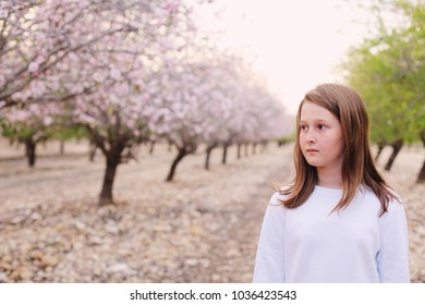 teen girl walking on rural blossom park