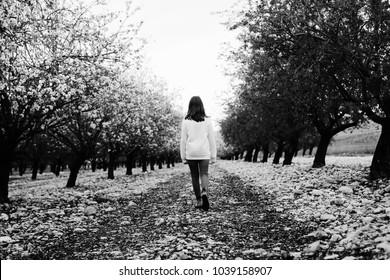 teen girl walking on rural blossom park
