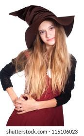 teen girl wearing halloween witch costume