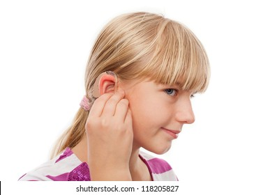 Teen girl wearing a hearing aid. Studio shot-isolated on white background.