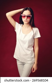 teen girl in white clothes and glasses