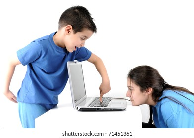 Teen girl working on computer while cute boy looking from above isolated on white background.
