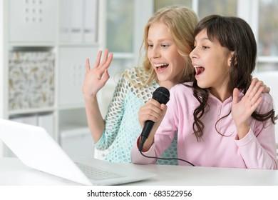 teen girls singing karaoke