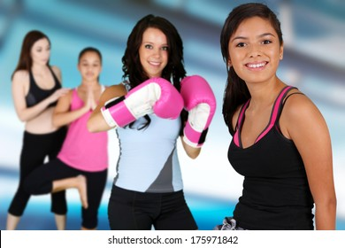 Teen girls working out in the gym