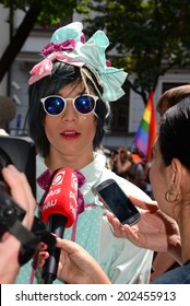 A teen giving an interview to local media at Gay Parade on the Bratislava Rainbow Pride, on June 28, 2014 in Bratislava, Slovak Republic.