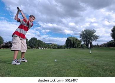 Teen golfer tees off