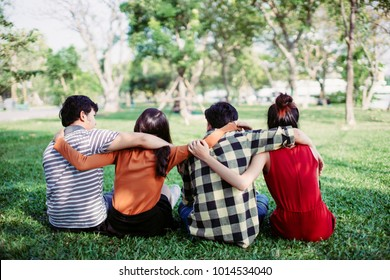 teen group people siting and hug in a park, friendship teenager concept.