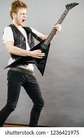 Teen Hardcore Man Wearing Metal Outfit Playing On Electric Guitar Heavy Rock Music Having Yelling Screaming