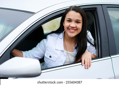 Teen in her new car going for a drive