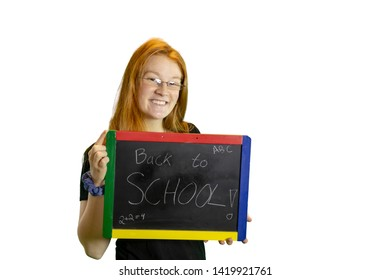 Teen holding blackboard with back to school isolated on white with copy space.