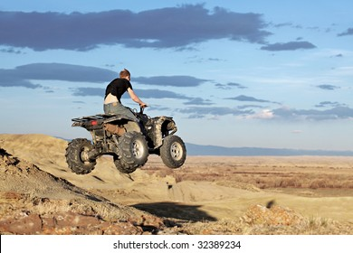 teen jumping on a quad - four wheeler 4x4 gets some air