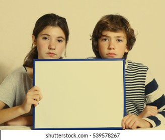 teen kids boy and girl hold blank paper sheet