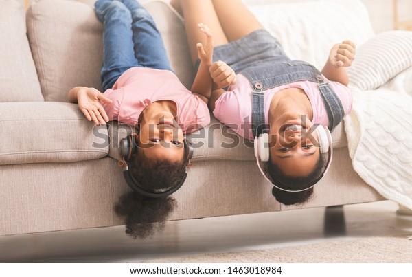 Astounding Teen Little Black Girls Enjoying Music Stock Photo Edit Now Natural Hairstyles Runnerswayorg