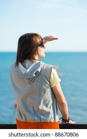 Teen looking out towards the horizon, a future concept