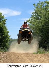 teen on a fourwheeler getting some air