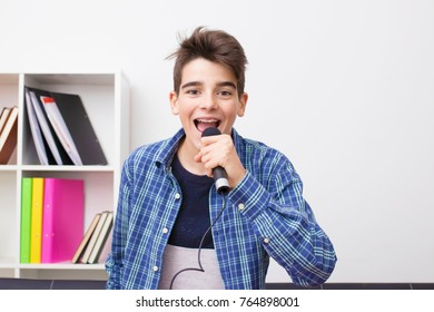 teen or preteen child with microphone singing at home