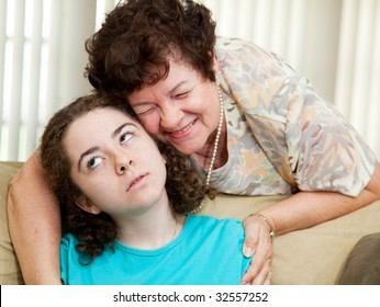 Teen puts up with a hug from an annoying aunt or parent.