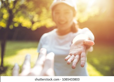 Teen reach her hand touch together and help concept beautiful love memory selective focus at girl hand.