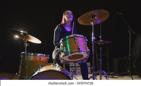 Teen rock music - attractive girl percussion drummer perform music break down