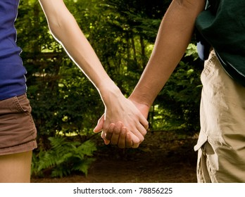 Teen romance - Caucasian girl, African American boy holding hands