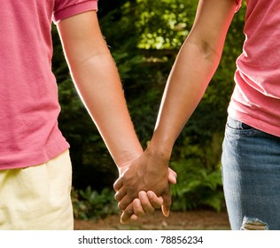 Teen romance - Hispanic boy and African American girl holding hands